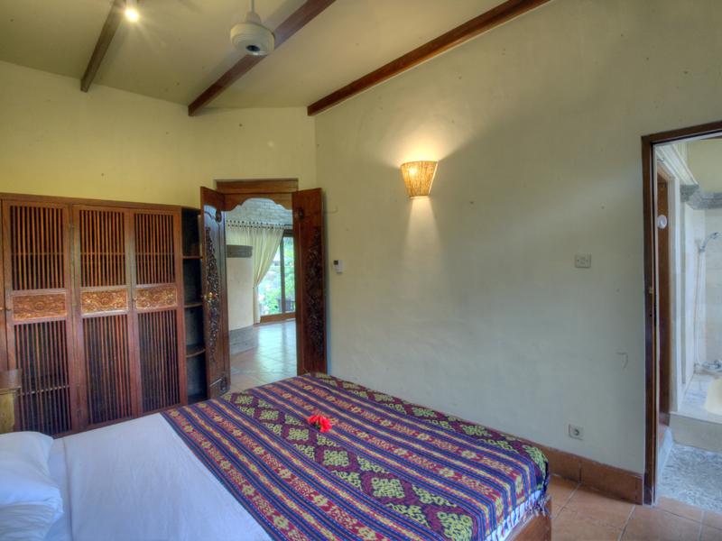 Private garden villa villa tepi kali Master bedroom with private garden